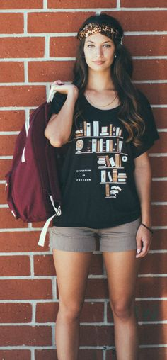 Teachers & book lovers... this one's for YOU! :) Each shirt purchased helps provide an education for children in need.