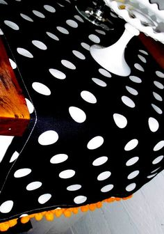 love me some black & white polka dots Ha!....just bought fabric and pom, poms to make me a runner just like this!