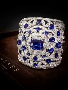 A sculptural diamond and sapphire ring