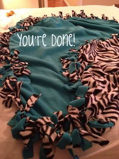 Step by step direction to make a tie blanket! If you are making for a big kid or just a throw size, then you will need 2 yds of each color fabric you choose. For a full adult size I would get 3 yards each ...