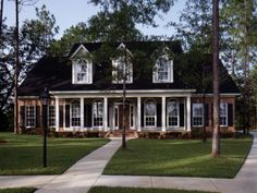 Symmetrical Southern Home With Triple Front Dormers