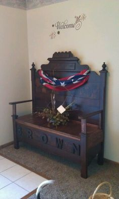 Bench made from an old bed frame. Rebel flag. Flower arrangements from my dad's funeral and our last name. Welcome piece at our front door.