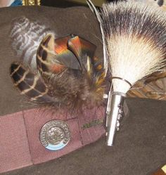 Hunting hat pin: Boykin Spaniel Society pin, feathers from hunts, my grandfathers gamsbart and 30 yr old hunting hat