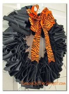 Black burlap wreath and orange zebra ribbon bow! Made by yours truly.