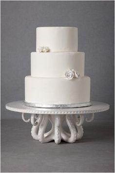 25 Decorating Ideas For a Dreamy Beach Wedding: Choose an elegant cake stand that fits your beach theme, like this Tentacled Server Cakestand ($248).