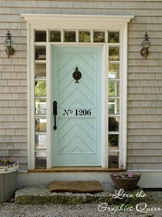I love this color for the front door. I works great with the gray exterior and I could see it paired with red shutters! So cute!