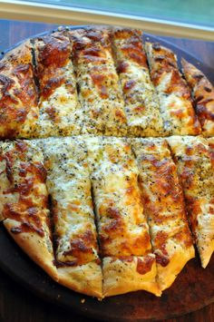 Cheesy Bread:   1 loaf Rhodes bread dough, thawed  1 -2 Tbsp. butter, softened  1 1/2 – 2 cups mozzerella cheese, shredded  1/4 cup parmesan cheese, shredded  1 Tbsp. + 1 tsp. Italian seasoning