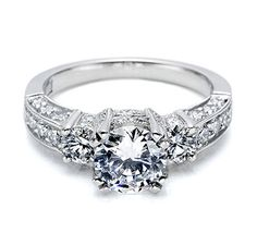 Tacori-Define your love in style with diamond rounds decorating both the tops and sides of this three-stone diamond engagement ring. Two large round diamonds surround a brilliant center stone, and special details accent the diamond just below the crown.