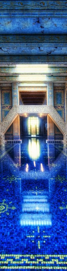 Blue indoor pool at
