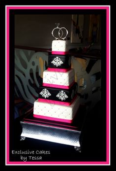Hot pink, black and white 5 tiered square fondant wedding cake by Exclusive Cakes by Tessa