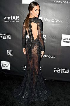 Alessandra Ambrosio wore a black snake-print dress with head-to-toe sheer panelling, that hid her most intimate parts by Zuhair Murad.