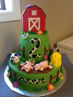 This cake is iced in green buttercream smoothed with the Viva method. The animals are fondant, as are the flowers and fence. The barn is RKT covered in fondant. The haystack is a mini cupcake. Thanks to all the great barn cakes here on CC for the ideas and inspiration!