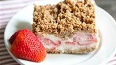 Frozen Strawberry Crunch Cake is the perfect frozen treat to serve at an outdoor summer get together.