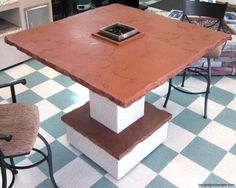 Fire-Pit/Bar Table, solid rust/brown color, amber/brown crushed glass veining, hand chiseled front edge. Done by James McGregor with McGregor Designs