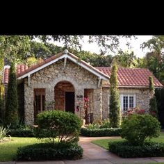 Beautiful Coral House in Coral Gables.  I lived in a coral rock cottage with stonework and tile roof similar to this!