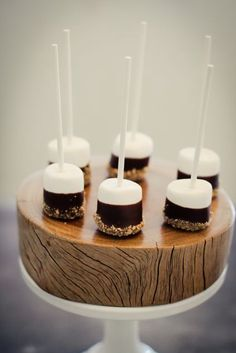 Marshmallows dipped in chocolate and nuts. Easy wedding appetizer! :)