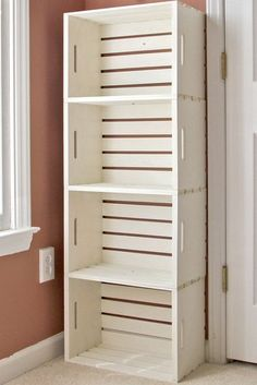 DIY crate bookshelf made from wooden crates from the craft store (Michaels under $13) - great for shoe storage!