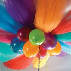 Rainbow birthday balloon and tulle decor. Could be done cheaper with table cloths and get same effect!