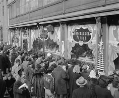 Last minute Christmas Eve shoppers gather in front of Macy's window display in New York, Dec. 24, 1946.