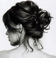 I love the tendrils hanging down her neck.