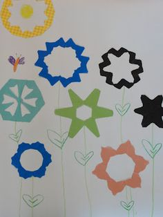 Simple Spring Flowers - made the same way you make paper snowflakes!