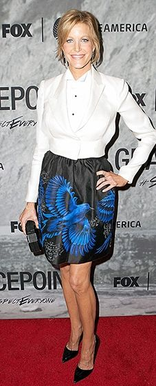 Anna Gunn wore an elegant cream blazer paired with a black skirt with a bold royal blue design. Coordinating black pumps and a matching box clutch finished the look.