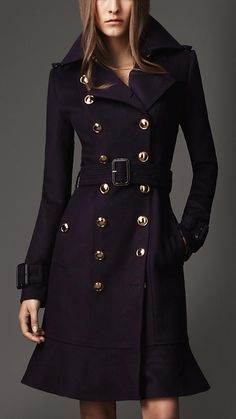 Burburry, wow I love the style of this coat.     Classy yet with eyecatching detail, like the buttons.