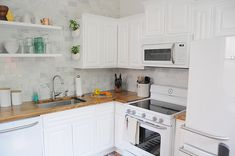Love this fabulous white kitchen - and I need those GE appliances.