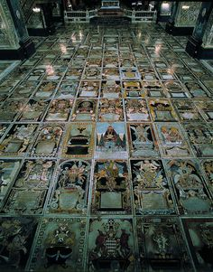 The floor of St John's Co Cathedral in Valletta Malta is made up of a kaleidoscopic collection of inlaid marble tombstones depicting the heraldic triumphalia of the grandest Order of Chivalry in the world