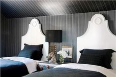 Problem: The bedroom furniture blends into the dark walls. Solution: Choose furnishings with some contrast like these white beds. @Antonio Covelo Martins