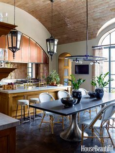 Meant to evoke the great service kitchens of the past, this kitchen has a tiled barrel-vault ceiling and rough-coat plaster walls.