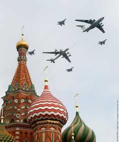 Russian military aircraft fly in formation over St. Bazils Cathedral in Red Square there are 4 F22, Cargo Plan is bigger than our C-5, last big one is a Bear Cat Bomber