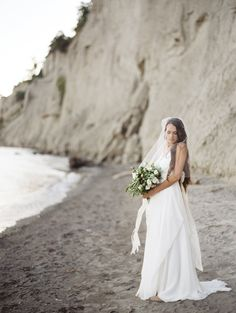 beach bride, photo by Jessica Rose Photography http://ruffledblog.com/romantic-beach-inspiration-in-toronto #brides #weddingideas