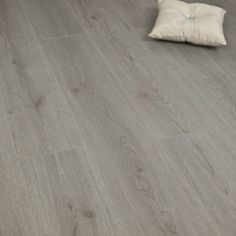Artisan trend dark grey 7mm v groove ac3 from for Balterio vanilla oak laminate flooring