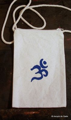 Hand Printed OM Small Purse on a String by AeryckdeSade on Etsy, $12.50