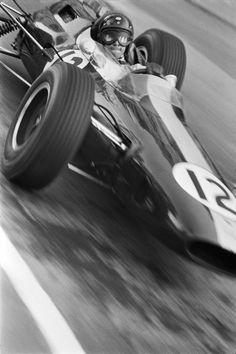 Jim Clark in the 1964 Monaco Grand Prix, who set pole in his number 12 Lotus but finished fourth due to an engine malfunction.