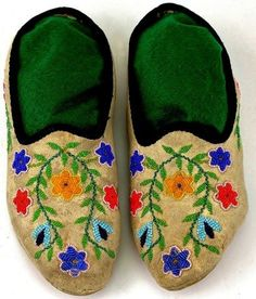 C. 1900 Santee Sioux beaded moccasins with black cloth lined openings