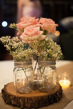 Simple #WeddingCenterpieces in Mason Jars I Golightly Images I See more @WeddingWire http://www.weddingwire.com/biz/golightly-images-wylie/portfolio/863fca76421db946.html?page=4&subtab=album&albumId=0954d5dc88f43570#vendor-storefront-content