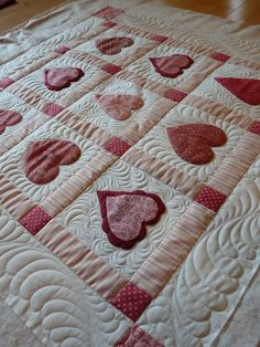 ~ Heart Quilt ~ Love the different stitching around the hearts....