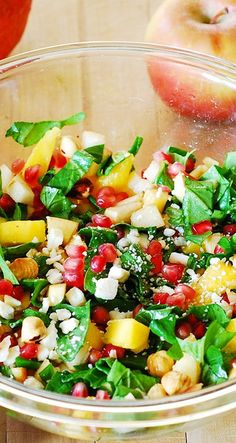Chopped salad with spinach, pomegranate seeds, mango, apples, pears, hazelnuts, and Gorgonzola cheese.