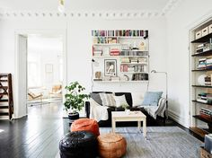 Black floors - via cocolapinedesign.com. love the poufs grouped together as secondary seating.