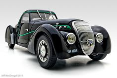 1937 Peugeot 302 Darl'mat Coupe--black with green trim.