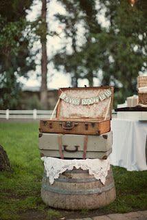 Suitcases and wine barrel half...