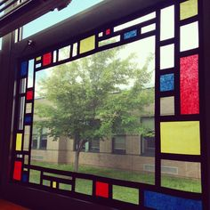 Mondrian windows with tissue paper and black electrical tape, in Katie Brown's art room.