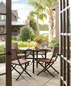 Create a backyard oasis with Martha Stewart Living patio sets. We love this Franklin Park combo with wicker chairs.