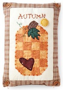 A little cross stitch adds the finishing touch to this sweet autumn throw pillow.