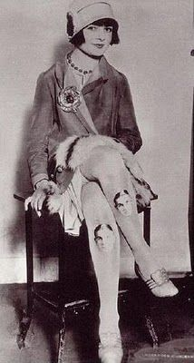 Miss Kitty Lee w/ portrait of her boyfriend printed on her stockings, 1920s