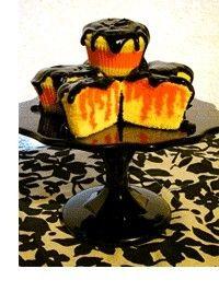 Halloween cupcakes--yellow poke cake with orange jello and chocolate icing!
