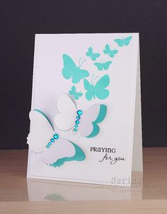 handmade sympathy card:Wing and a Prayer by Nerina's Cards ... white with aqua ... swarm of butterflies arching into the sky ... fabulous upward movement  ... delightful!!
