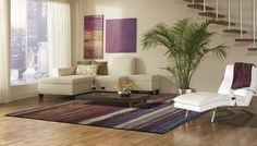 So we added a great area rug from our Pissaro Collection. Bold, dramatic and intense! These are words that come to mind when looking at the Pissarro rug collection. Purple, beige and a range darker tones blend in abstract combinations within this collection. It is for those who wish to make a bold statement. The pile is densely textured and durable! On Sale  at our online store! Details   http://bit.ly/ypluvX
